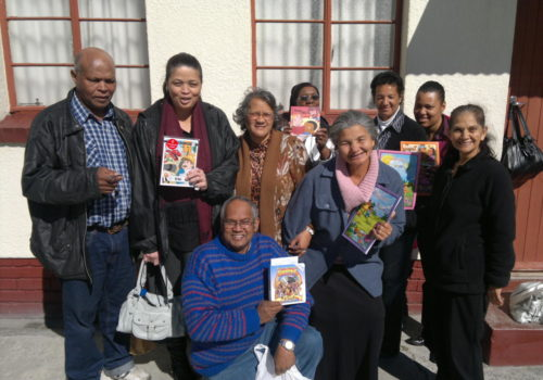 Sunday School Teachers in Grassy Park, Cape Town receiving a donation of books from Bhanoo after attending a presentation on Teaching Kids by Family Care